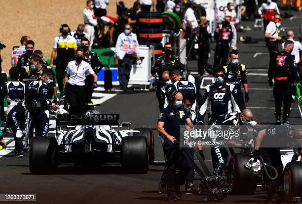 Scuderia AlphaTauri team members prepare on the grid before the F1 Grand Prix of Great Britain at Silverstone on August 02, 2020 in Northampton,...