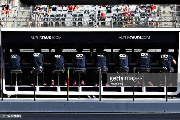 Scuderia AlphaTauri team members sit on the pitwall during the F1 Grand Prix of Russia at Sochi Autodrom on September 27 2020 in Sochi Russia