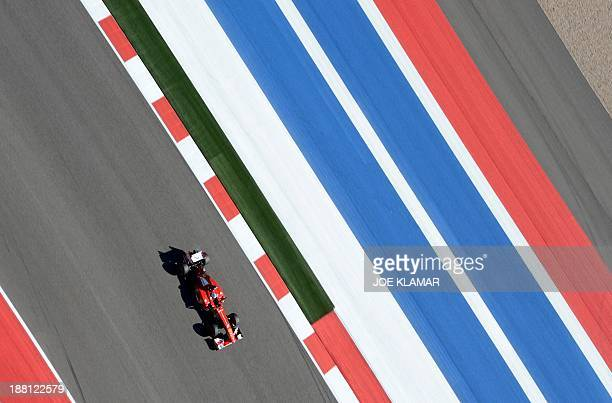 Scuderia Ferrari driver Fernando Alonso of Spain competes during a practice round for the United States Formula One Grand Prix at Circuit of The...