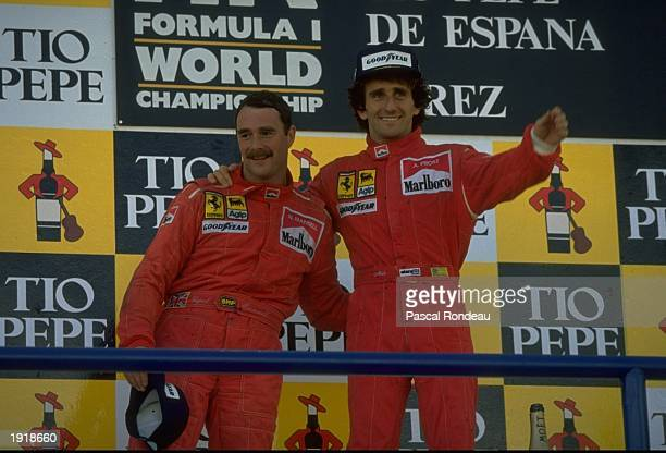 Scuderia Ferrari drivers Nigel Mansell of Great Britain and Alain Prost of France stand on the winners'' podium after the Spanish Grand Prix at the...