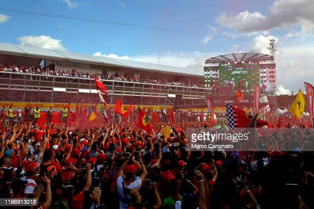 Scuderia Ferrari supporters , attend the awards ceremony after the Italian Formula One Grand Prix.