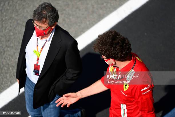 Scuderia Ferrari Team Principal Mattia Binotto and Ferrari CEO Louis C Camilleri talk before the F1 Grand Prix of Tuscany at Mugello Circuit on...