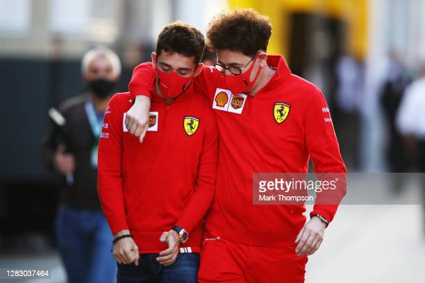 Scuderia Ferrari Team Principal Mattia Binotto embraces Charles Leclerc of Monaco and Ferrari as they walk in the Paddock during previews ahead of...