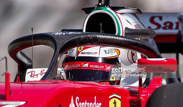 Scuderia Ferrari's driver Kimi Raikkonen tests the socalled halo cockpit protection device during first practice session of the Formula One Brazilian...