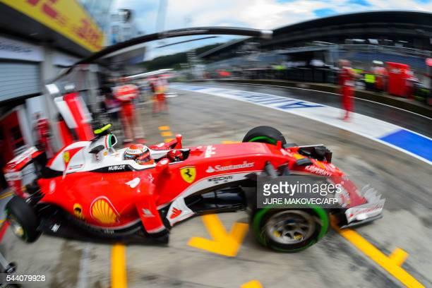TOPSHOT Scuderia Ferrari's Finish driver Kimi Raikkonen leaves the pit lane during the second practice session of the Formula One Grand Prix of...