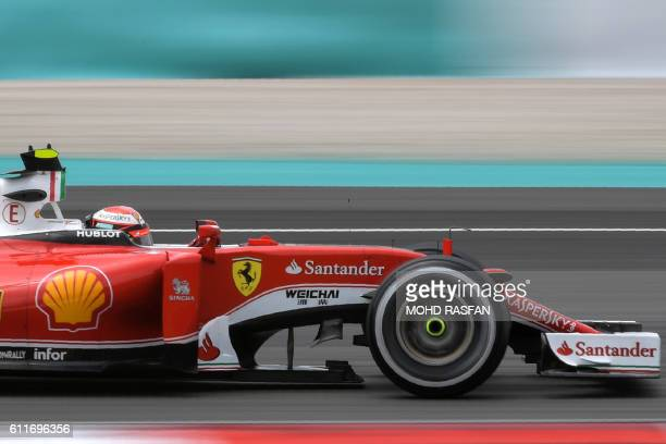 Scuderia Ferrari's Finnish driver Kimi Raikkonen drives his car during the third practice session of the Formula One Malaysian Grand Prix in Sepang...
