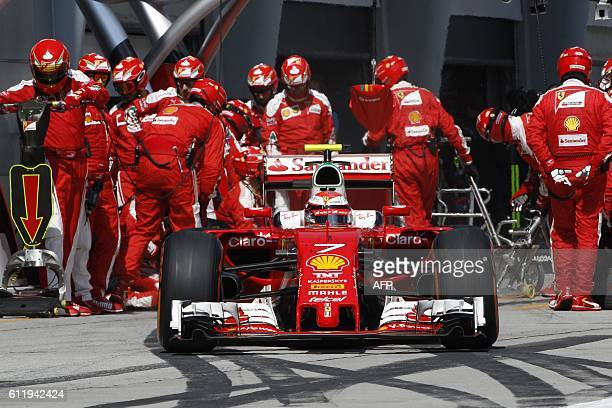 Scuderia Ferrari's Finnish driver Kimi Raikkonen leaves the pit lane after changing his tyres during the Formula One Malaysian Grand Prix in Sepang...