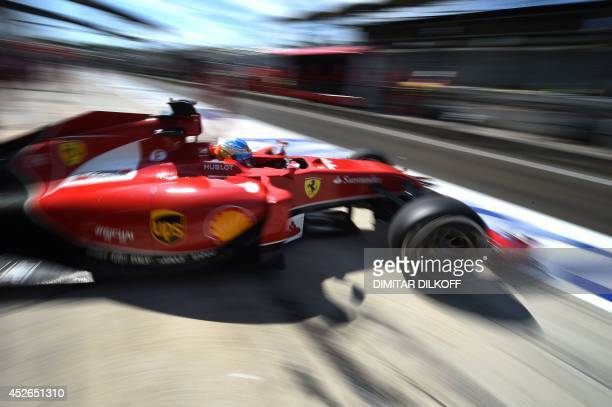 Scuderia Ferrari's Finnish driver Kimi Raikkonen leaves the pits during the first practice session at the Hungaroring circuit in Budapest on July 25,...