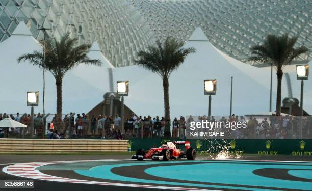 Scuderia Ferrari's Finnish driver Kimi Raikkonen steers his car during the qualifying session as part of the Abu Dhabi Formula One Grand Prix at the...
