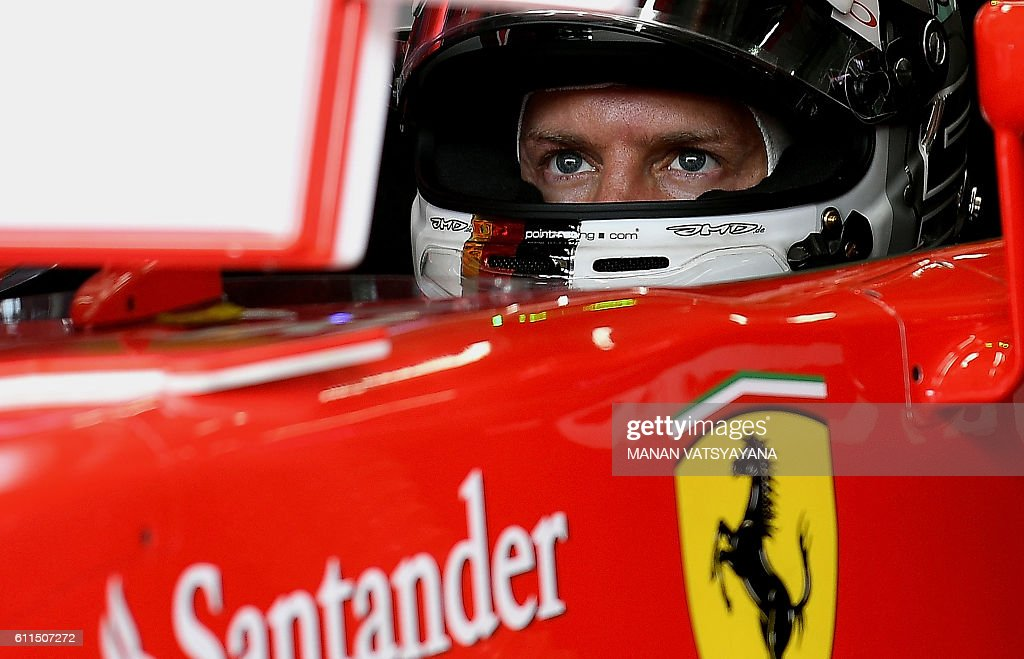 Scuderia Ferrari's German driver Sebastian Vettel prepares to drive out of the pit during the second practice session of the Formula One Malaysian Grand Prix in Sepang on September 30, 2016. / AFP / MANAN