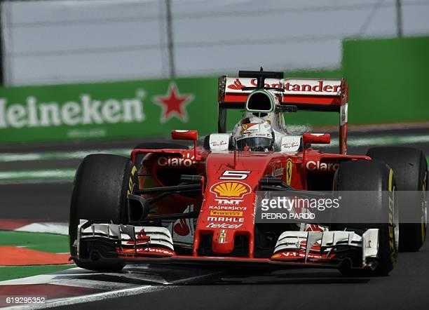 Scuderia Ferrari's German driver Sebastian Vettel speeds during the Formula One Mexico Grand Prix at the Hermanos Rodriguez circuit, in Mexico City...