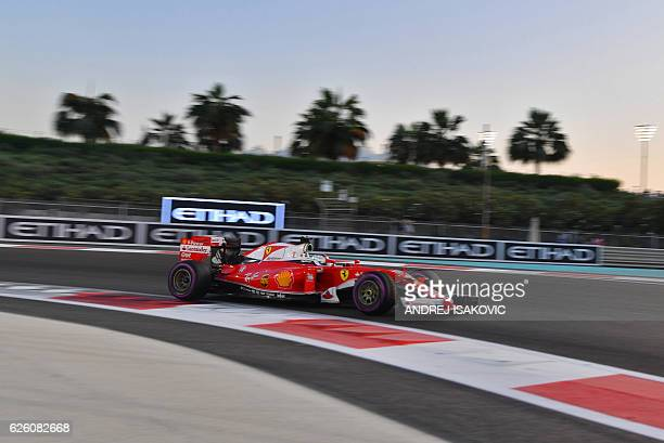 Scuderia Ferrari's German driver Sebastian Vettel steers his car during the Abu Dhabi Formula One Grand Prix at the Yas Marina circuit on November 27...