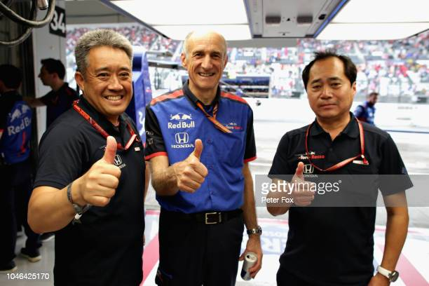 Scuderia Toro Rosso Team Principal Franz Tost celebrates with Toyoharu Tanabe and Masashi Yamamoto of Honda F1 itg during qualifying for the Formula...
