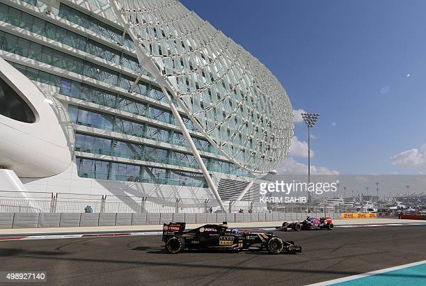 Scuderia Toro Rosso's Belgian-Dutch driver Max Verstappen passes back facing Lotus F1 Team's reserve driver Jolyon Palmer drive during the first...