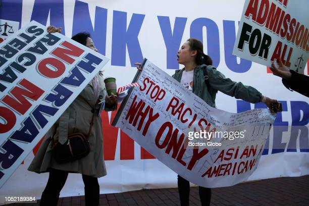 A scuffle between protesters ensues as a group of Chinese Americans who support President Trump raised a banner thanking the President at a rally in...