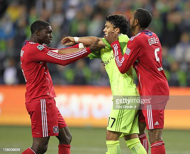 A scuffle breaks out between Fredy Montero of the Seattle Sounders FC Jalil Anibaba and Cory Gibbs of the Chicago Fire during the 2011 Lamar Hunt US...
