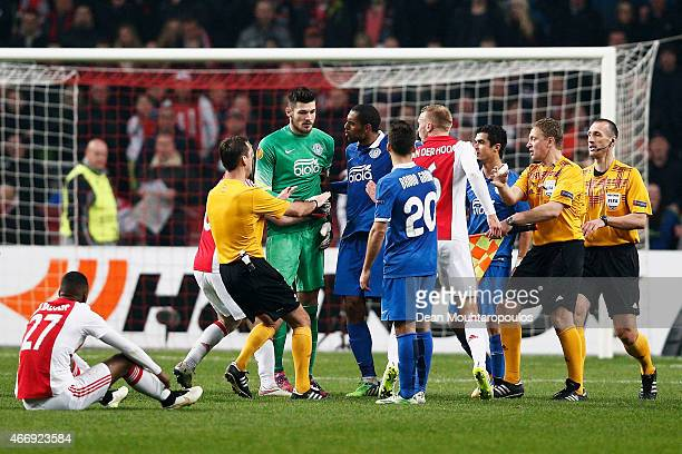 Scuffle breaks out between goalkeeper Denys Boyko of Dnipro and Mike van der Hoorn of Ajax following the finalk whistle during the UEFA Europa League...