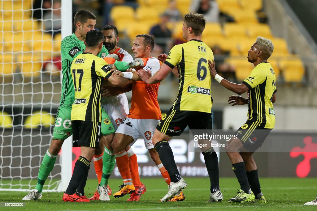A scuffle breaks out between Keegan Smith and Ali Abbas of the Phoenix and Fahid Ben Khalfallah and Eric Bautheac of Brisbane during the round four A-League match between the Wellington Phoenix and the Brisbane Roar at Westpac Stadium on October 28, 2017 in Wellington, New Zealand.