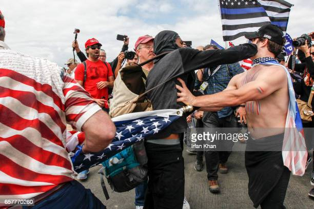 A scuffle breaks out between ProTrump and AntiTrump protestors during Make America Great Again March on March 25 2017 in Huntington Beach According...