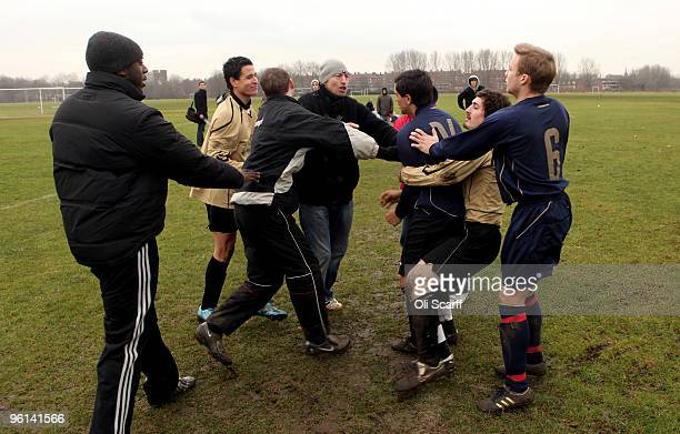 A scuffle breaks out between rival Sunday League teams after a late tackle on the Hackney Marshes pitches on January 24 2010 in London England...