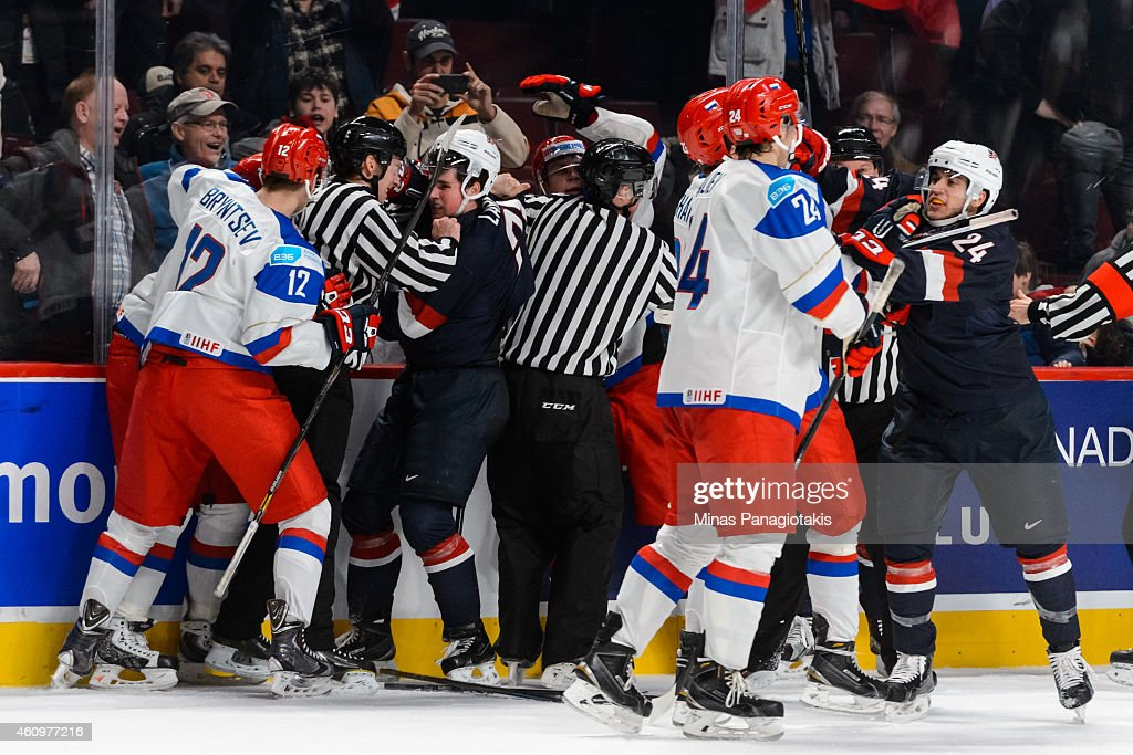 A scuffle breaks out between Team Russia and Team United States at the end of the game in a quarterfinal round during the 2015 IIHF World Junior Hockey Championships at the Bell Centre on January 2, 2015 in Montreal, Quebec, Canada. Team Russia defeated Team United States 3-2.