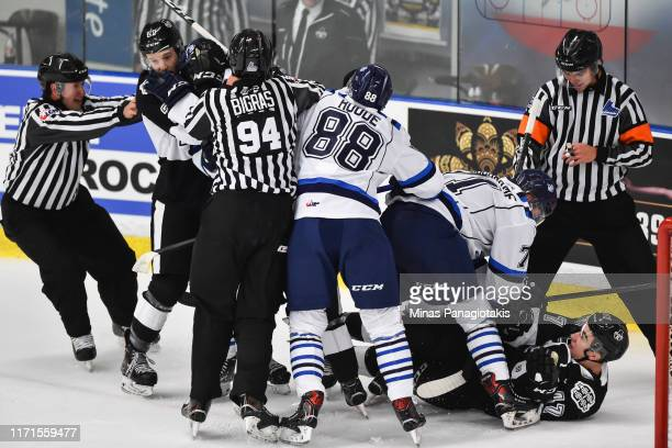 Scuffle breaks out between the Chicoutimi Sagueneens and the Blainville-Boisbriand Armada during the QMJHL game at Centre d'Excellence Sports...