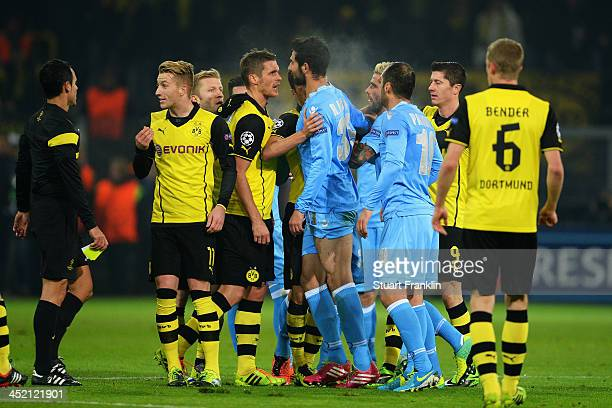 A scuffle breaks out between the opposing players during the UEFA Champions League Group F match between Borussia Dortmund and SSC Napoli at Signal...