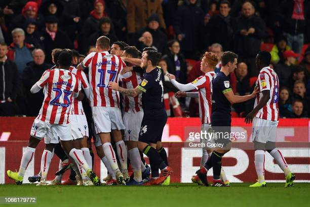 A scuffle breaks out between the two teams during the Sky Bet Championship match between Stoke City and Derby County at Bet365 Stadium on November 28...
