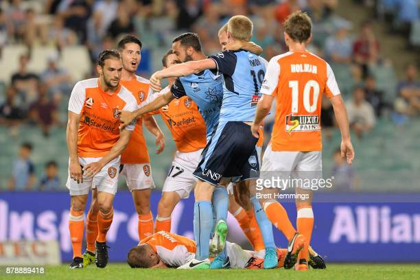 A scuffle breaks out in play during the round eight ALeague match between Sydney FC and the Brisbane Roar at Allianz Stadium on November 25 2017 in...