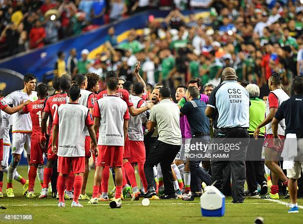 Scuffles break between members of Panama's and Mexico's national teams after the referee awarded Mexico a controversial penalty during g a CONCACAF...