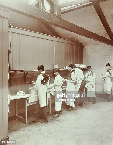 Scullery practice, Sailors' Home School of Nautical Cookery, London, 1907. A group of boys washing various kitchen utensils. Artist: unknown.