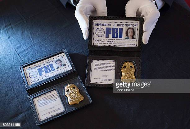Scully Mulder FBI Photo ID Badge from The XFiles estimated at £3k£5k each go on display ahead of the Prop Store Rare Film and TV Memorabilia auction...