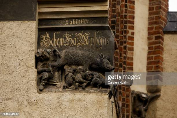 Sculpted relief shows the controversial 'Judensau,' or 'Jew's Sow' that shows Jews suckling from the teets of a pig on the facade of the 13th-century...