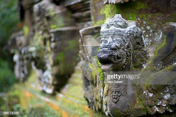 a sculpted temple ornament on a balinese temple near ubud. - alex saberi stock-fotos und bilder