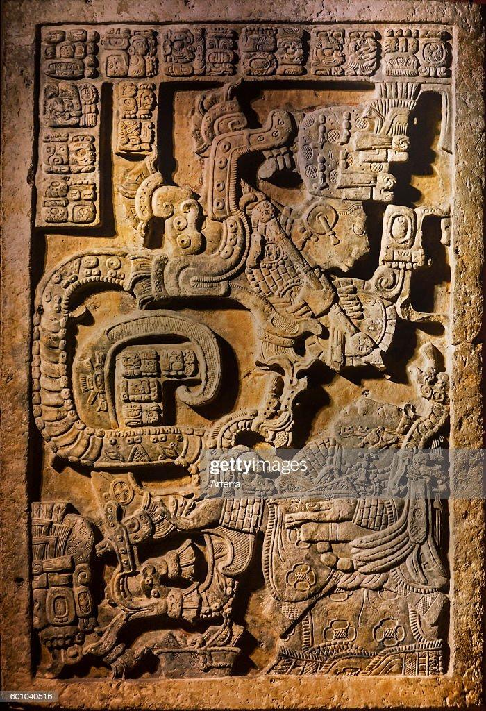 Sculpted Yaxchilan lintel 25 showing hieroglyphic inscriptions being