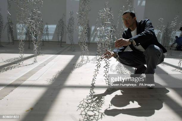 Sculpter and artist Antony Gormley stands with his 'Domain Field' exhibition which he unveiled at the Baltic Gallery in Gatehead The exhibition of...