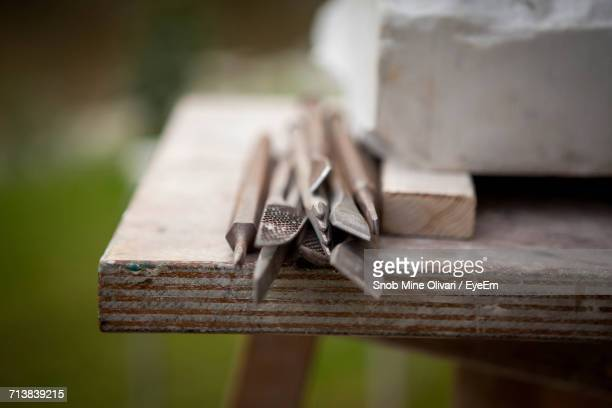 Sculpting Tools On Wooden Table In Yard