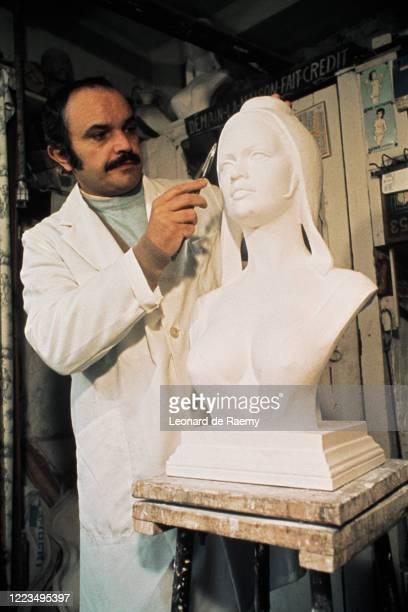 Sculptor Alain Aslan sculpts a bust of Brigitte Bardot as Marianne