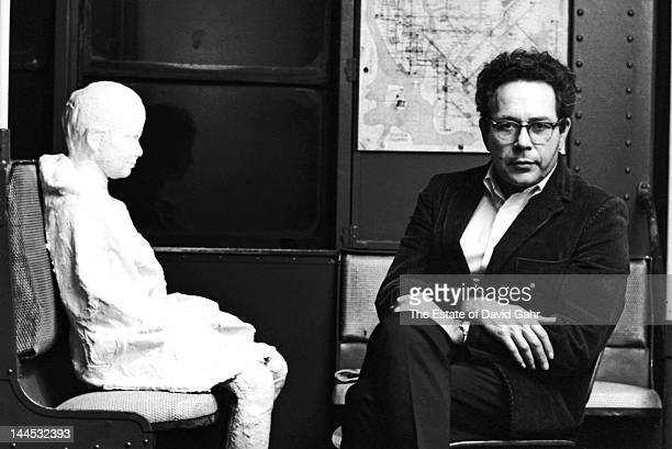 Sculptor and painter George Segal poses for a portrait in 1966 at Sidney Janis Gallery in New York City New York