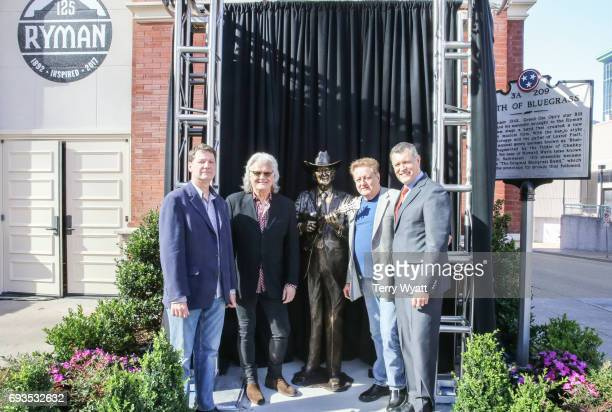 Sculptor Ben Watts, Ricky Skaggs, James Monroe and Billy Cody attend the unveiling of statues of Little Jimmy Dickens and Bill Monroe at Ryman...