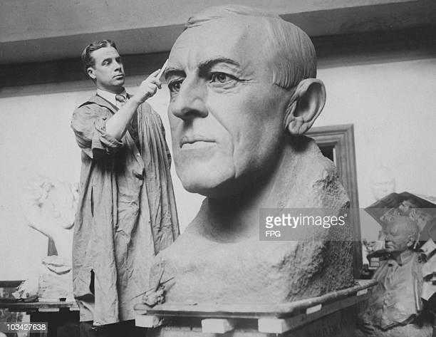 Sculptor Bryant Baker with a bust of Woodrow Wilson , the 28th President of the United States of America circa 1938. The bust was to be presented to...