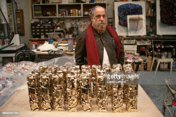 Sculptor Cesar in his studio in front of Cesar statuette awards that he created for the French award ceremony