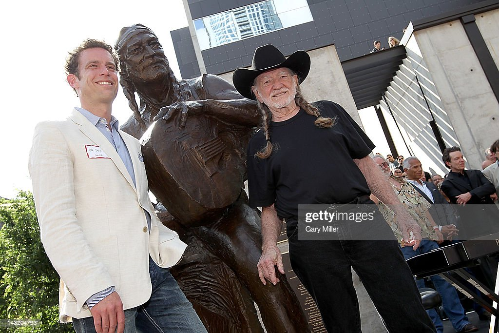 Sculptor Clete Sheilds (L) and Willie Nelson pose after the unveiling of Willie Nelson's statue at ACL Live on April 20, 2012 in Austin, Texas.