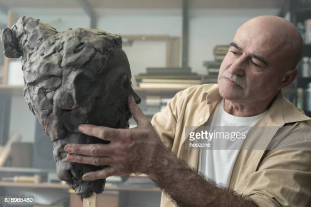 sculptor creates a clay sculpture - sculptor stock pictures, royalty-free photos & images