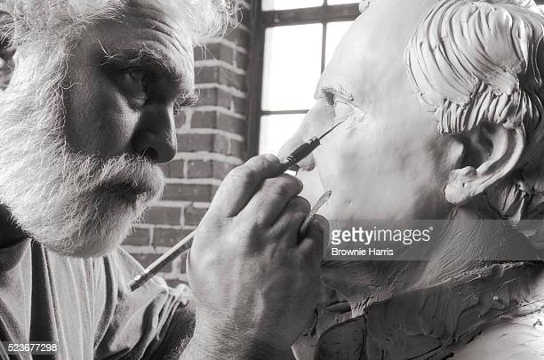 sculptor detailing clay bust - sculptor stock pictures, royalty-free photos & images