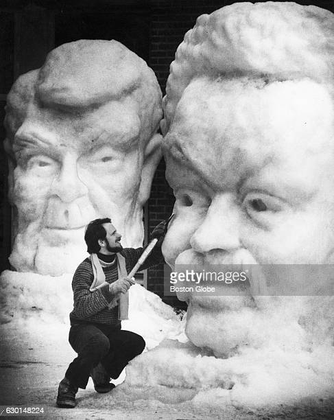 Sculptor Emile Birch works on a snow sculpture of presidential candidate Jesse Jackson at Eagle St Marketplace in Concord NH on Jan 29 1984 A Ronald...