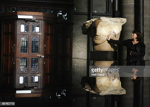Sculptor Emily Young stands besides one of the seven and a half newly sculpted Angel Heads that have been installed at Salisbury Cathedral on...
