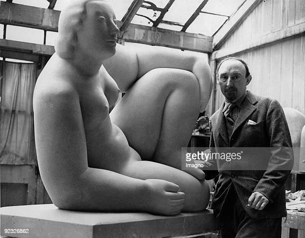 Sculptor Frank Dobson posing next to one of his sculptures which is being displayed at the Leicester Gallery in London Photograph Around 1935