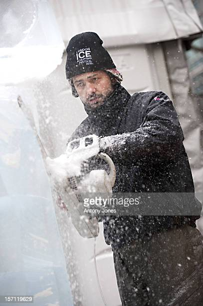 A Sculptor Is Seen Carving Giant Blocks Of Ice For Entry Into The London Ice Sculpting Festival 2010 At Canary Wharf London