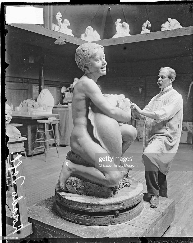 sculptor lorado taft at work on the fountain of the great lakes